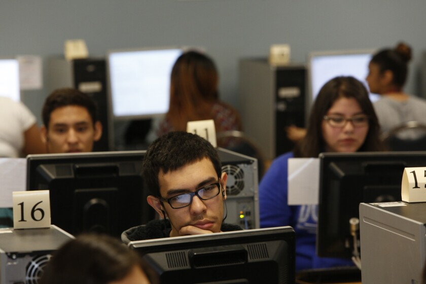 Bryan Casillas, center, concentrates as 11th-grade students at Francisco Bravo Medical Magnet High School practice last Februrary for new state standardized tests. Magnet students did comparatively well on the tests.