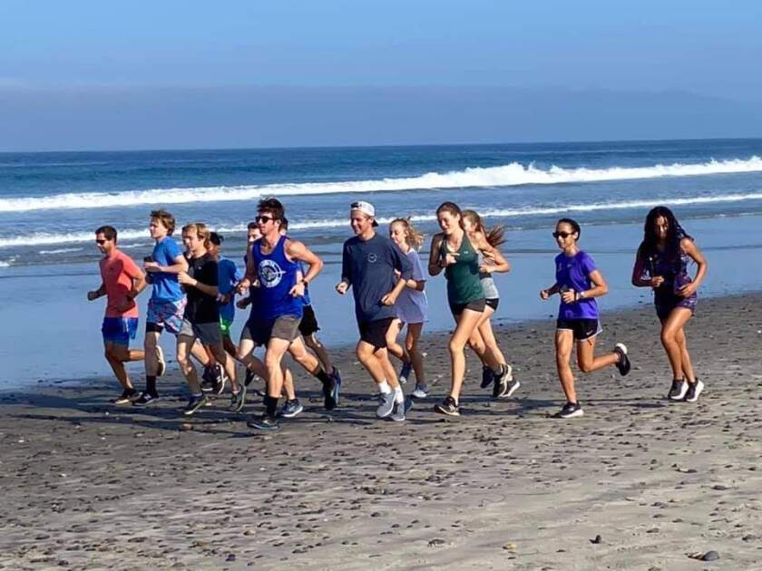 The Ramona High School cross country team practices included the annual beach run Aug. 14.