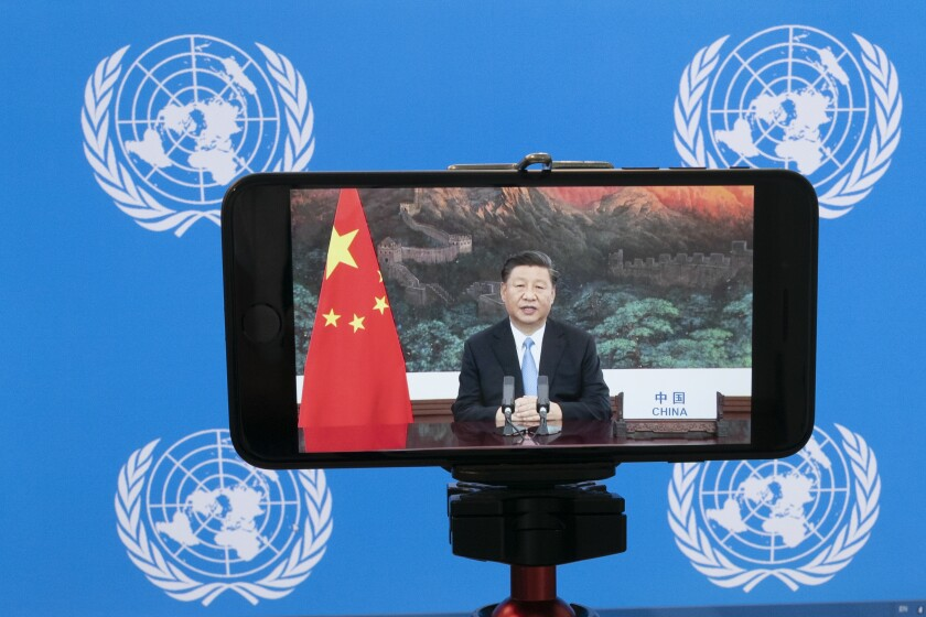 "Chinese President Xi Jinping is seen on a video screen remotely addressing the 75th session of the United Nations General Assembly, Tuesday, Sept. 22, 2020, at U.N. headquarters. This year's annual gathering of world leaders at U.N. headquarters will be almost entirely ""virtual."" Leaders have been asked to pre-record their speeches, which will be shown in the General Assembly chamber, where each of the 193 U.N. member nations are allowed to have one diplomat present. (AP Photo/Mary Altaffer)"