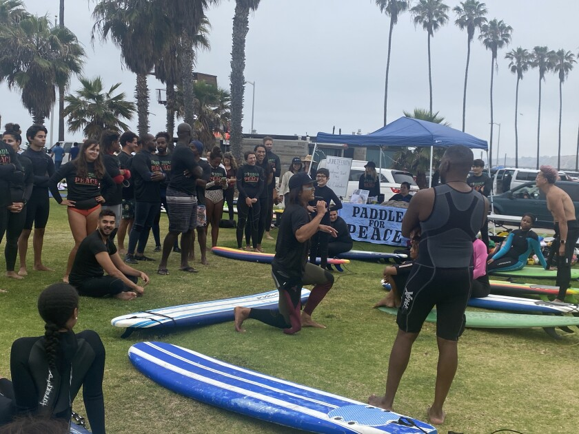 About 30 volunteer surf instructors gave lessons to about 40 surfing newbies for International Surf Day and Juneteenth.