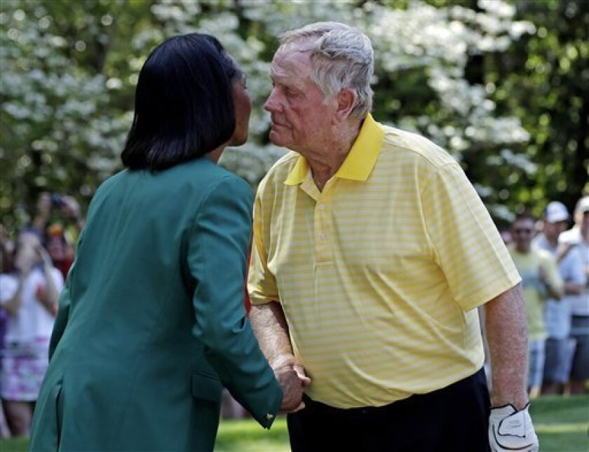 Jack Nicklaus gives former Secretary of State Condoleezza Rice a kiss on her cheek during the par three competition before the Masters golf tournament Wednesday, April 10, 2013, in Augusta, Ga. (AP Photo/David J. Phillip)