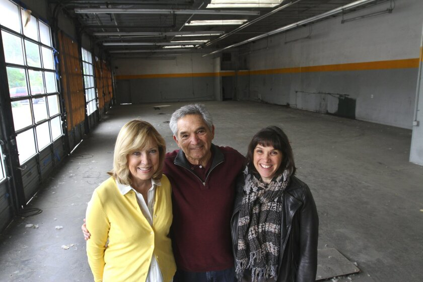 Lou Kashmere (center), his wife, Sharon (left), and daughter Rena stand inside the closed tire shop he owns on Front Street in Temecula.