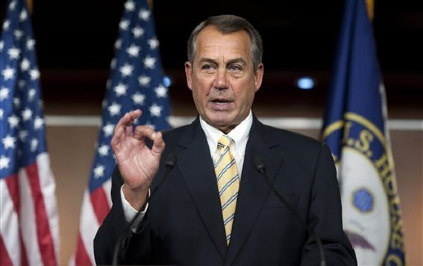 """House Speaker John Boehner of Ohio, makes a """"zero"""" gesture as he speaks with reporters about the federal budget on Capitol Hill in Washington, Thursday, March 14, 2013. Boehner was referring to President Barack Obama's federal budget which received zero votes in 2012 when it was rejected 414-0 in t"""