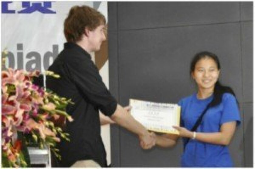 Catherine Wu, right, won the silver medal at the 12th International Linguistics Olympiad. The U.S. team won the gold. Courtesy photo
