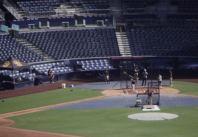 Eric Hosmer bats during a summer camp practice.