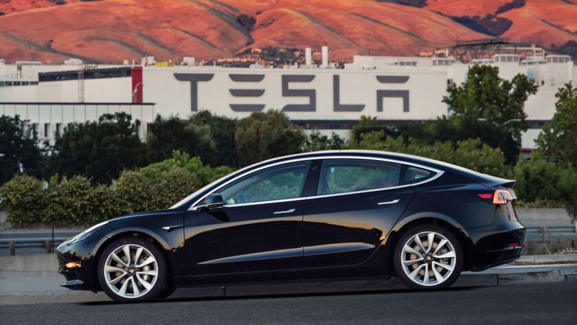 This undated image provided by Tesla Motors shows the Tesla Model 3 sedan. The electric car companyâ