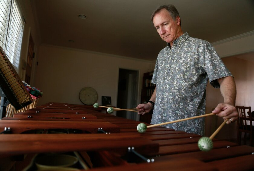 Jon Szanto, shown playing the marimba at his home,  SAN DIEGO, CA-MARCH 02, 2016: Jon Szanto plays the marimba at his San Diego home. In the 1970's and 80's, he was a member of the San Diego-based Harry Partch Ensemble. Szanto has performed with the San Diego Symphony since 1976. (Misael Virgen / S