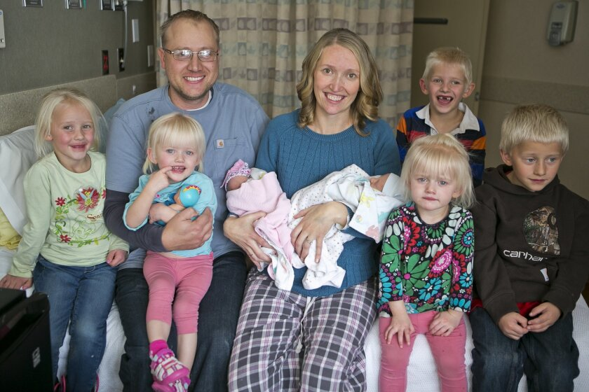 Tiffany and Chris Goodwin of Three Forks, Mont., pose for a family photo with their children, from left, Eliza, Brielle, Olivia, Carter, Mason, Emalynn and Josh on Wednesday, Nov. 4, 2015 at the Bozeman Health Deaconess Hospital in Bozeman, Mont. Tiffany gave birth to her third set of twins, Olivia