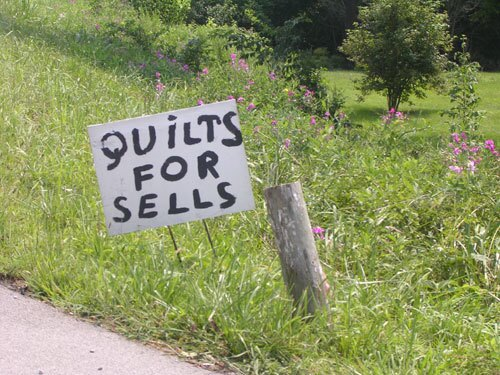 I buyz Tennessee quiltz? Submitter pamann took note of an odd sign in Crossville, Tennessee (population: 8,981). From the Your Scene album Weird America.