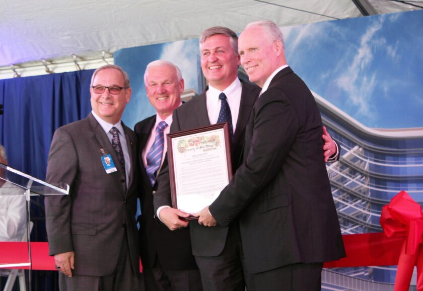 Scripps Memorial Hospital La Jolla chief executive Gary Fybel, County Supervisors Ron Roberts and Dave Roberts and Scripps Health president/CEO Chris Van Gorder pose with a proclamation bestowed to Prebys Cardiovascular Institute by the county.