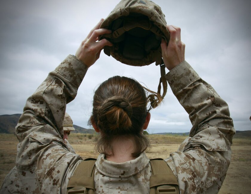 Marine Corps 2nd Lt. Rosemary Doyle, the Adjutant in Training with the 2nd Battalion, 11th Marine Regiment at Camp Pendleton, puts on her Kevlar helmet.