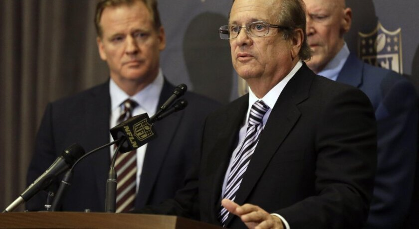 In this Jan. 12, 2016, file photo, NFL Commissioner Roger Goodell, left, listens as San Diego Chargers owner Dean Spanos talks to the media after team owners voted in Houston to allow the St. Louis Rams to move to a new stadium just outside Los Angeles, with the Chargers having an option to share t