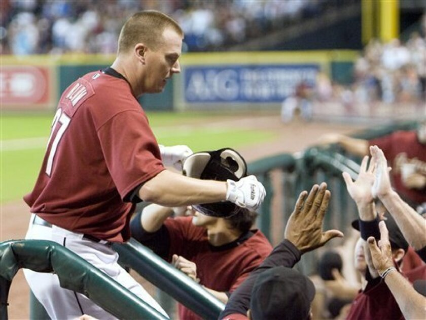 Houston Astros' Geoff Blum is congratulated after hitting a solo home run in the second inning against the Boston Red Sox in a baseball game Sunday, June 29, 2008, in Houston. (AP Photo/Bob Levey)