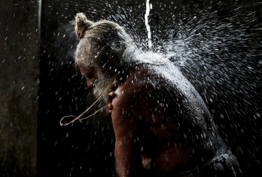 A Hindu man takes a holy bath before praying during Shivratri festival at Pashupatinath temple premises in Kathmandu, Nepal, Thursday, March 11, 2021. Shivratri, or the night of Shiva, is dedicated to the worship of Lord Shiva, the Hindu god of death and destruction. (AP Photo/Niranjan Shrestha)