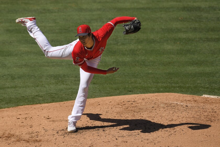 Angels pitcher Shohei Ohtani delivers a pitch.