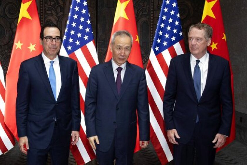 Chinese Vice Premier Liu He, center, with Treasury Secretary Steven T. Mnuchin, left, and U.S. Trade Representative Robert Lighthizer at the Xijiao Conference Center in Shanghai on July 31.