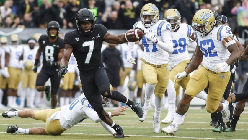 Oregon's Ugochukwu Amadi returns a punt for a touchdown against UCLA last season.