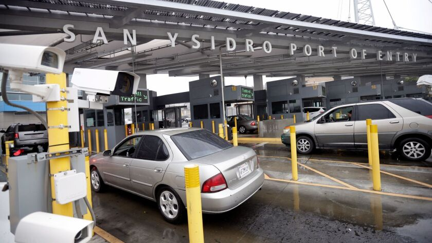 FILE - In this Dec. 3, 2014, file photo cars wait to enter the United States from Tijuana, Mexico th
