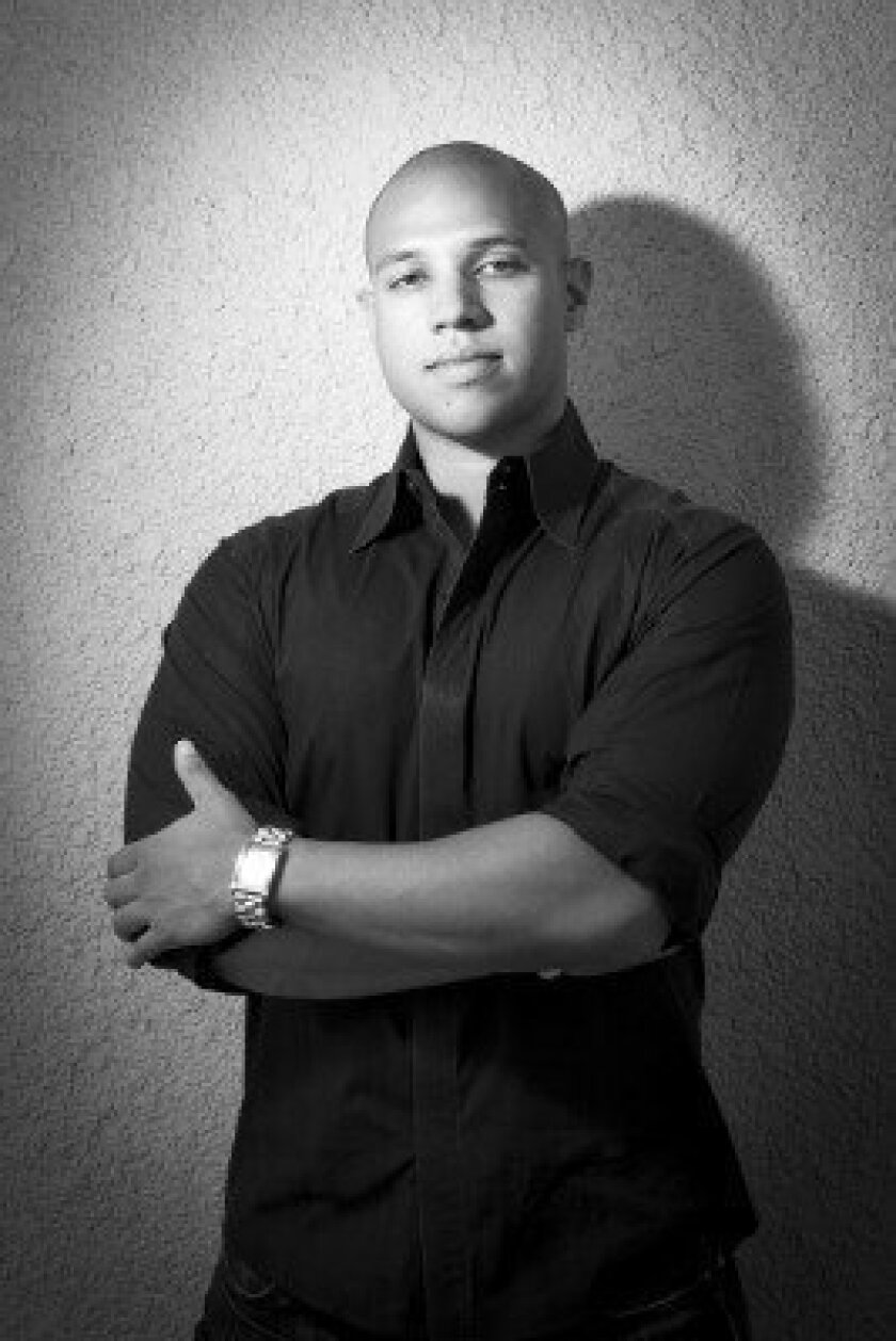 Darnell Holloway, manager of local business outreach for Yelp, will speak at workshop.