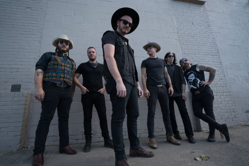 "The members of Vandoliers call themselves ""Converse cowboys,"" but their hard-driving music sounds better-suited for Doc Martens and cowboy boots."