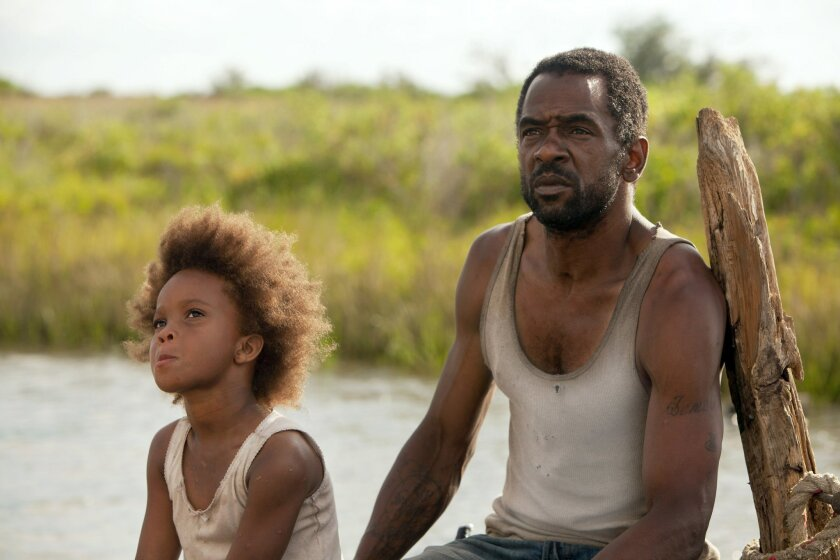 "MOVIE---Quvenzhane Wallis as ""Hushpuppy"" and Dwight Henry as ""Wink"" on the set of BEASTS OF THE SOUTHERN WILD. Photo By: Mary Cybulski http://press.foxsearchlight.com/node/334"