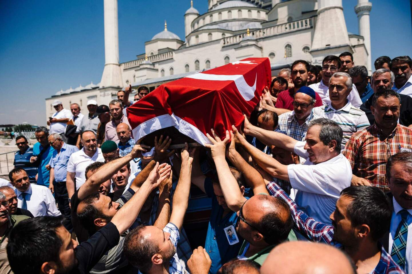 Mourners carry the coffin of a man who died during the coup attempt at a funeral ceremony at Kocatepe Mosque in Ankara, Turkey. Support from the highest ranks in the army helped keep President Recep Tayyip Erdogan in power.