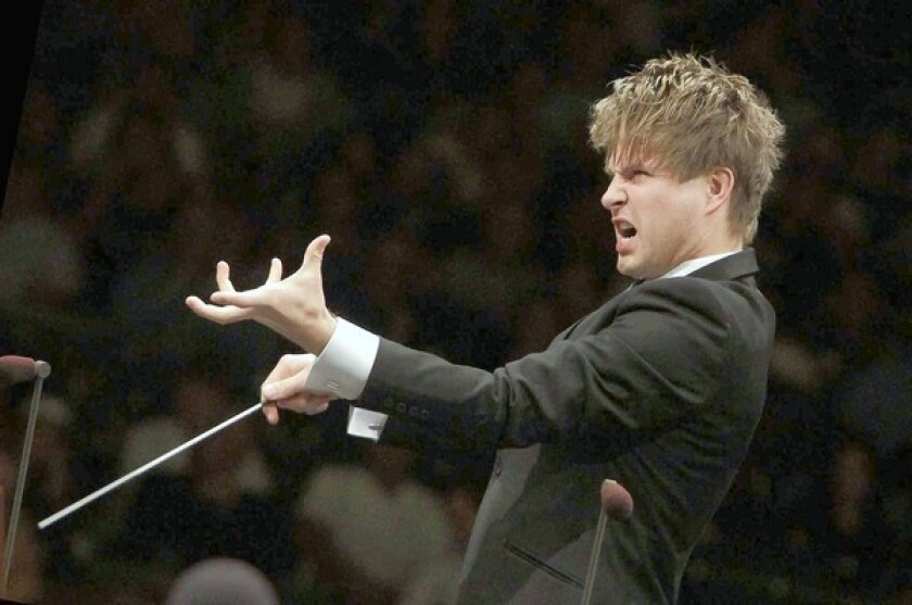 Music review: Young conductor impresses with L.A. Phil at Bowl