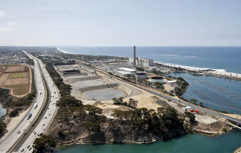 Much of San Diego County could benefit from the easing of water-conservation rules because of the desalination plant in Carlsbad, shown here in September.
