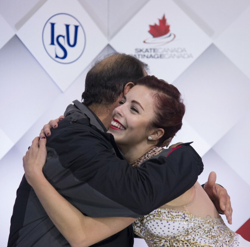 Ashley Wagner of the United States hugs her coach following the ladies free skate at Skate Canada International in Lethbridge, Alberta, Saturday, Oct. 31, 2015. (Jonathan Hayward/The Canadian Press via AP) MANDATORY CREDIT