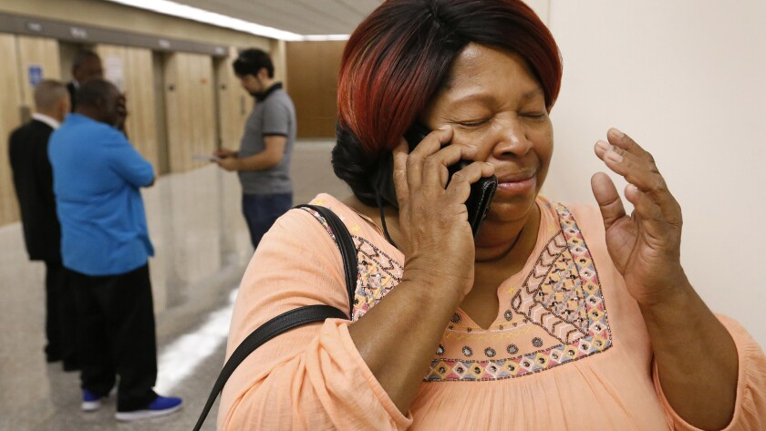 """Rosie Harmon, a sister of Bobby Joe Maxwell, the accused """"Skid Row Stabber"""" serial killer, is in tears as she calls their 84-year-old mother after a judge dismissed the charges against her brother, ending a 40-year legal odyssey."""