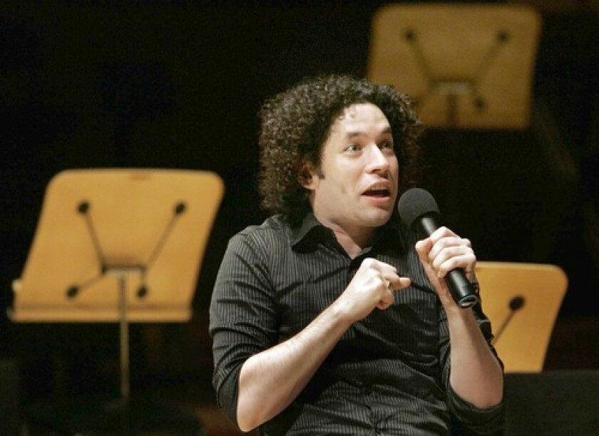 """ARE FLIP FLOPS OKAY? Conductor Gustavo Dudamel helps set the relaxed tone for """"Casual Fridays."""""""