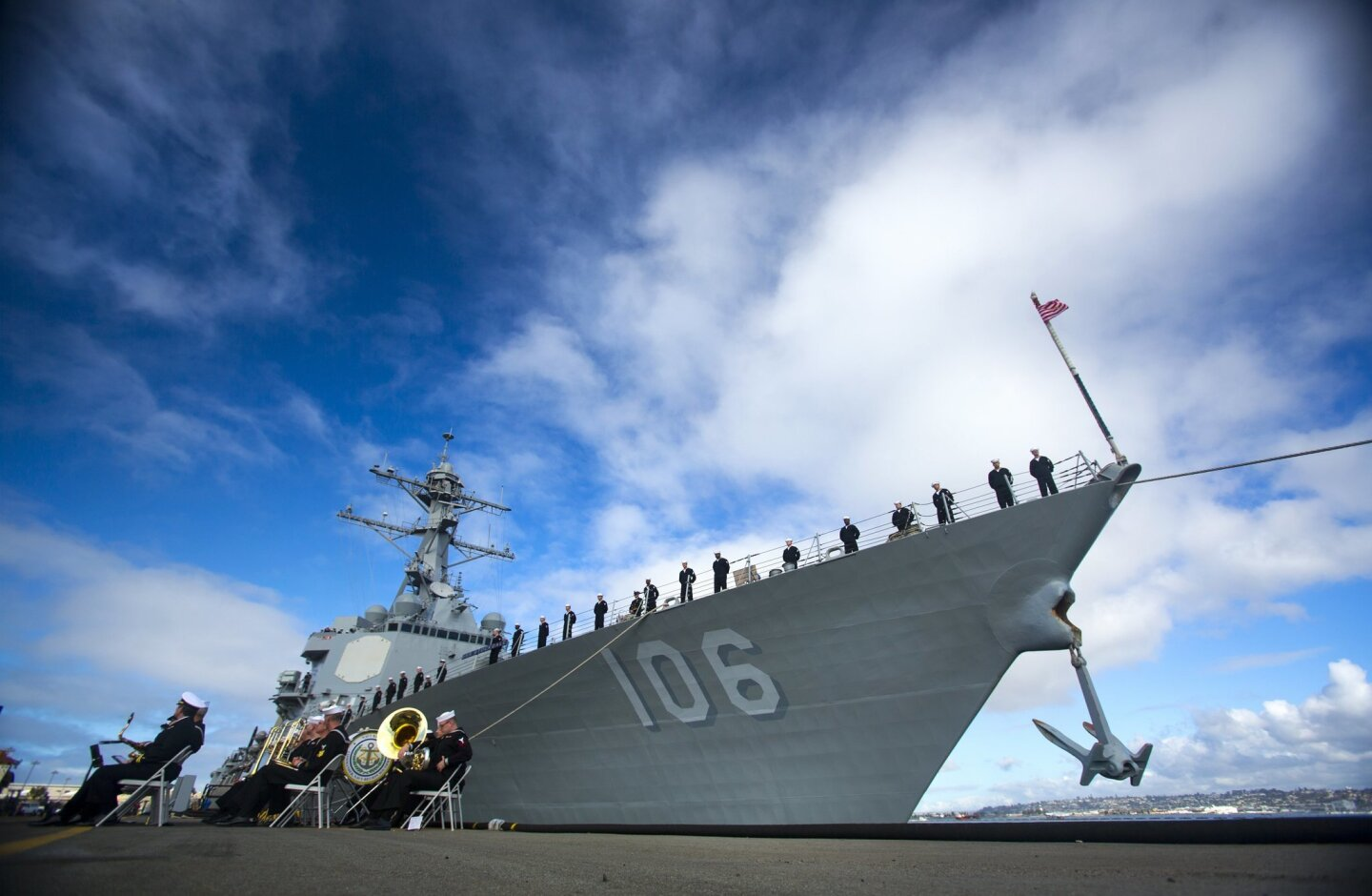 The guided missile destroyer USS Stockdale prepares to leave North Island Naval Air Station on a seven-month deployment as part of the USS John C. Stennis Carrier Strike Group, becoming the first ship in the U.S. Navy to regularly run on biofuel.