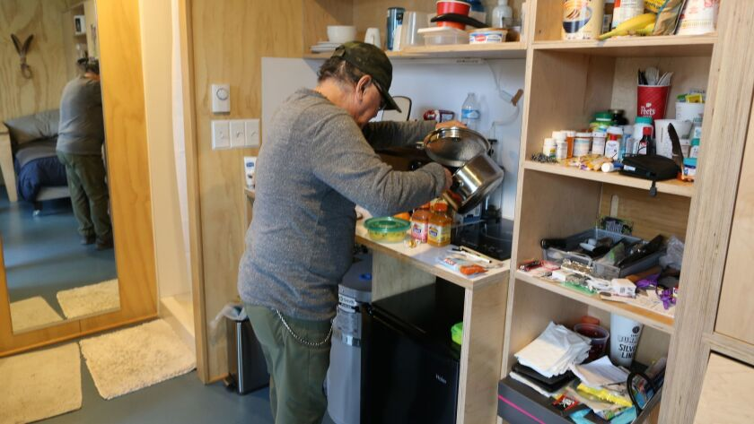 SEATTLE WA MARCH 30, 2018 -- Robert Desjarlais makes tea in his tiny house in Seattle, WA on March