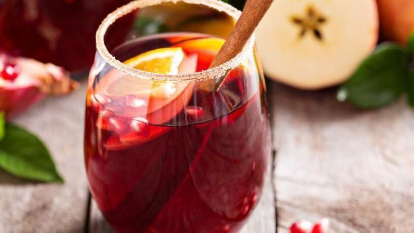 Sangria in a glass garnished with fruit