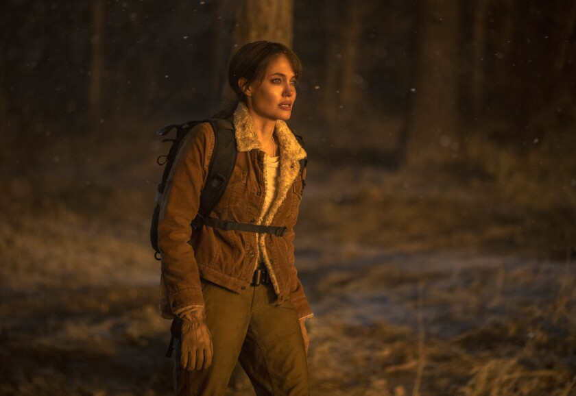 """This image released by Warner Bros. Entertainment shows Angelina Jolie in a scene from """"Those Who Wish Me Dead."""" (Emerson Miller/Warner Bros. Entertainment via AP)"""