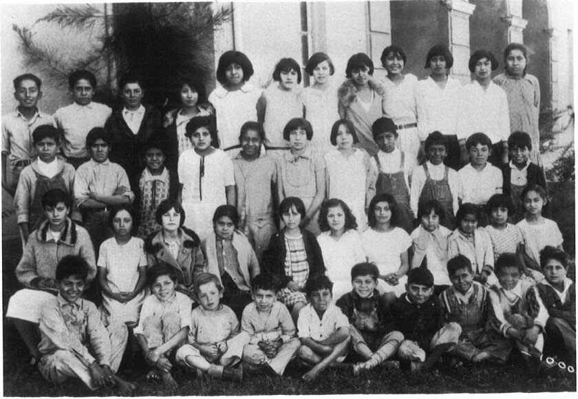 A class photo from around 1928 at Lemon Grove Elementary shows Robert Alvarez in the third row at left next to the teacher.