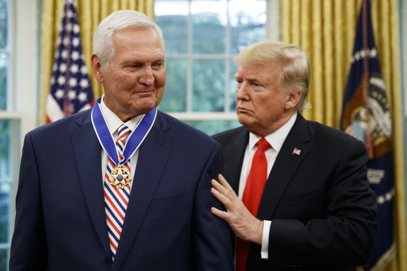 President Donald Trump presents the Presidential Medal of Freedom to former Laker and general manager Jerry West, in the Oval Office of the White House on Thursday in Washington.