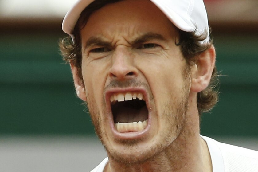 Britain's Andy Murray screams after scoring in the semifinal match of the French Open tennis tournament against Switzerland's Stan Wawrinka at the Roland Garros stadium in Paris, France, Friday, June 3, 2016. (AP Photo/Alastair Grant)