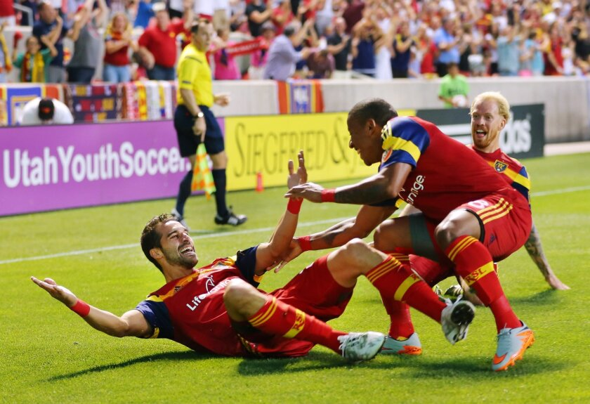 Real Salt Lake's Sebastian Jaime celebrates scoring a goal with teammates Joao Plata and Luke Mulholland an MLS soccer game against the Seattle Sounders, Saturday, Aug. 22, 2015, in Sandy, Utah. (Scott G Winterton/The Deseret News via AP) SALT LAKE TRIBUNE OUT; MAGS OUT; MANDATORY CREDIT