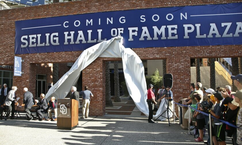 In an Aug. 26 ceremony that caused quite a furor in San Diego, Bud Selig (left) turns to see the unveiling of a sign announcing that the Padres were renaming a part of Petco Park in honor of the soon-to-retire commissioner.