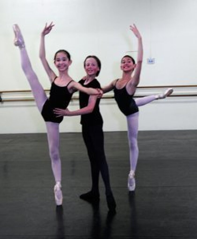 """Pictured at rehearsal for """"Cinderella"""" are (left-to-right): Michelle Kenyon, Brian Warkentien and Audrey Ponder. They are all 12 years old."""