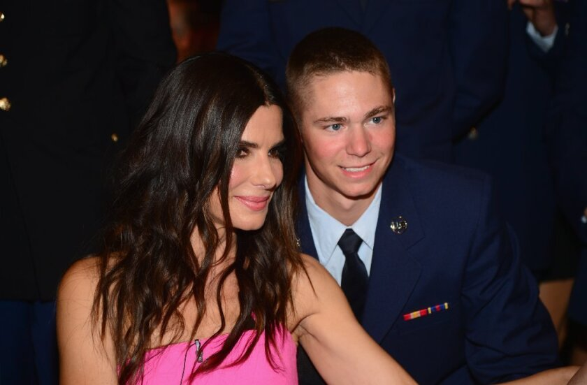 """Actress Sandra Bullock meets with U.S. troops during Spike TV's """"Guys Choice 2014"""" at Sony Pictures Studios in Culver City."""