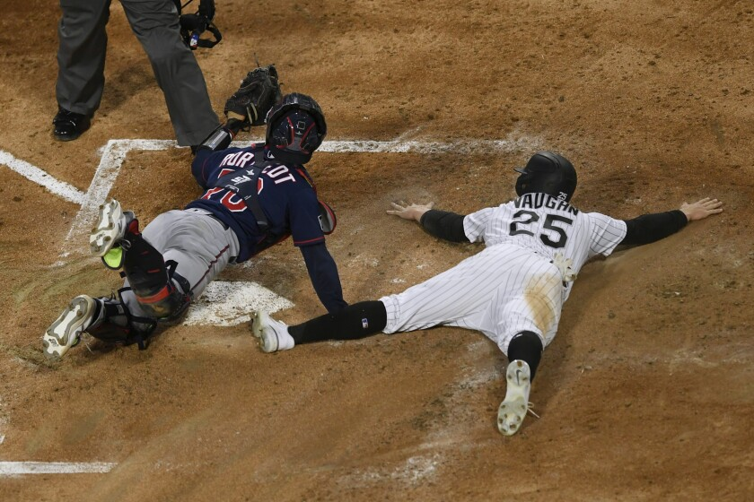 Minnesota Twins catcher Ben Rortvedt (70) looks to the home plate umpire for the call after tagging out Chicago White Sox's Andrew Vaughn (25) during the second inning of a baseball game Tuesday, May 11, 2021, in Chicago. (AP Photo/Paul Beaty)