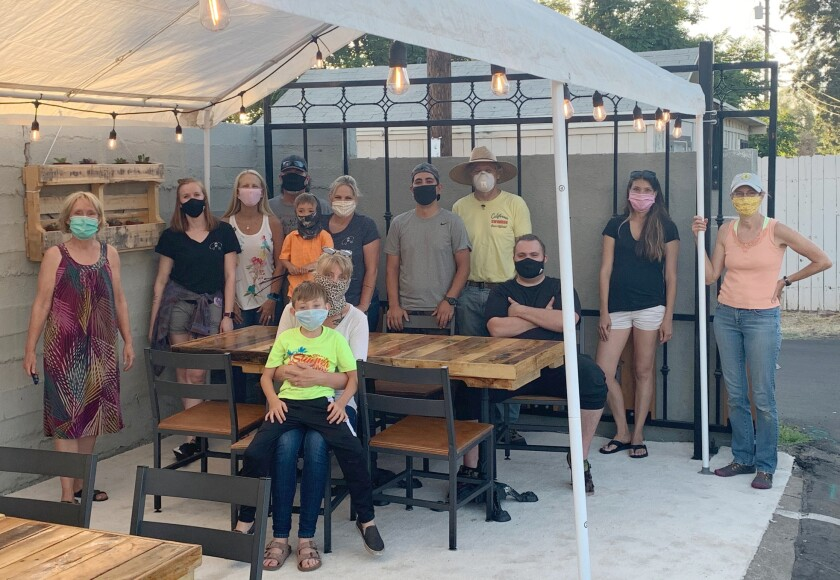 Volunteers spent an evening last week setting up an outdoor patio at the Marinade on Main restaurant.