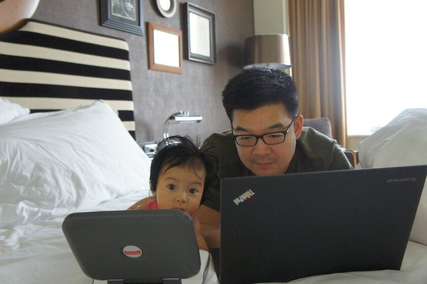 Chester Ng works remotely in Sydney, Australia, alongside his daughter Mackenzie.