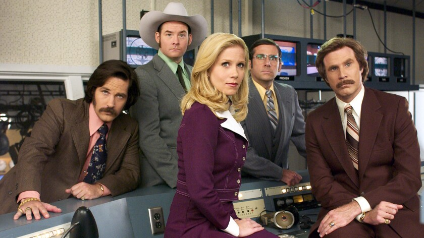 "The anchors in ""Anchorman: The Legend of Ron Burgundy"" include Veronica Corningstone (Christina Applegate, seated center), lead anchor Ron Burgundy (Will Ferrell, far right), Brian Fantana (Paul Rudd), left, Champ Kind (David Koechner) and Brick Tamland (Steve Carell)."