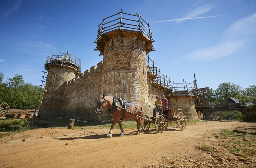 GUEDELON CASTLE, FRANCE - MAY 23: Laetitia Roux drives her horse and cart, which is used to transpor
