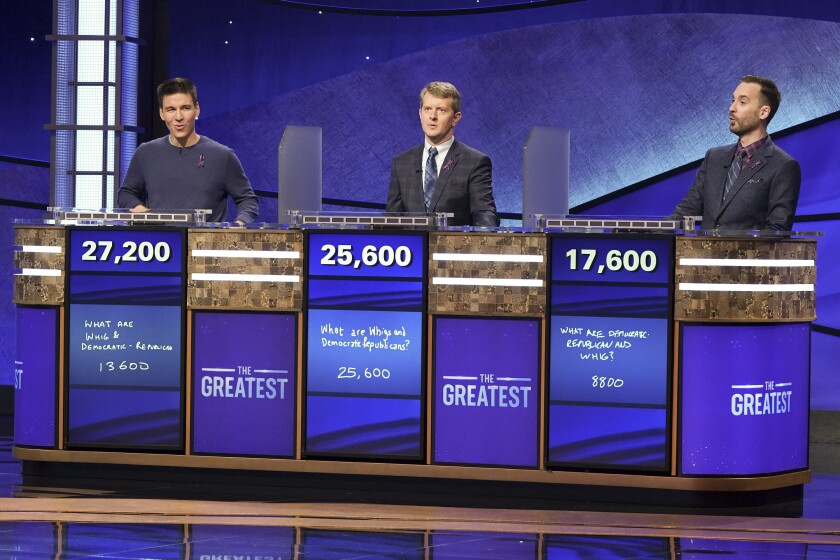 """Jeopardy!"" contestants, from left, James Holzhauer with 27,200 points; Ken Jennings with 25,600; Brad Rutter with 17,600."