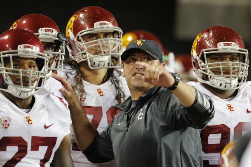 Steve Sarkisian coaches the USC Trojans against Arizona on Oct. 11.