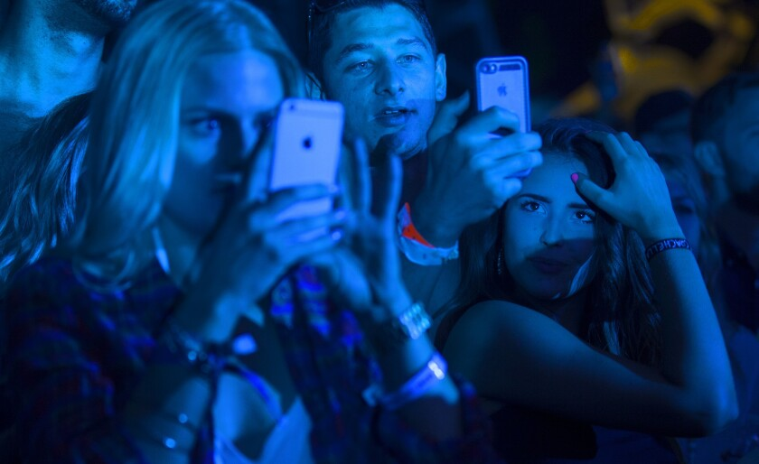 Coachella attendees using cellphone cameras